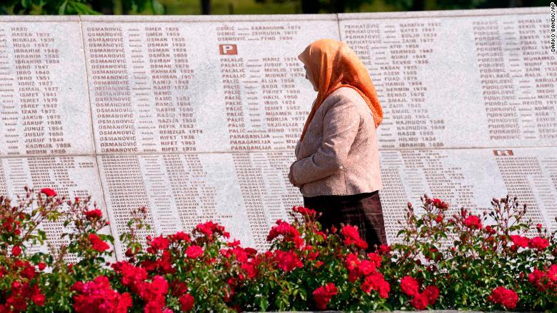 A woman observes the names of victims of the Srebrenica massacre, at the memorial cemetery in Potocari, near Srebrenica, eastern Bosnia, Tuesday, June 8.