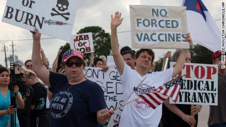 Employees protest Houston hospital policy for all employees to get vaccinated against COVID-19 staff