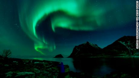 A person watches the northern lights on March 9, 2018, in Utakleiv, northern Norway.
