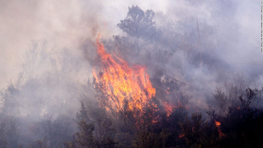 The area around Arizona's wildfires is so dry, firefighters' heavy equipment is causing small flareups