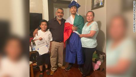 Recent graduate Ever Lopez with his family.