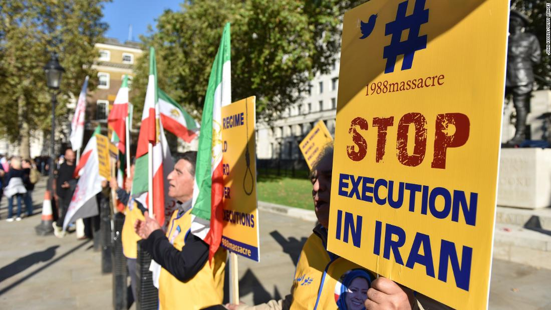 People protest against Iran's death penalty opposite Downing Street as a march to demand a people's vote against Brexit passes by on October 2018 in London, England.