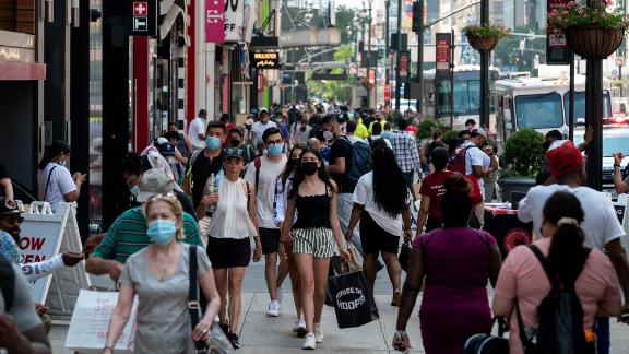 People walk through a shopping area in Manhattan on June 7, 2021 in New York City.