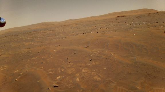 This image looking west toward the Séítah geologic unit on Mars was taken from the height of 33 feet (10 meters) by NASA's Ingenuity Mars helicopter during its sixth flight, on May 22, 2021.