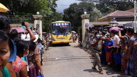Relatives wait for a bus carrying prisoners to be released outside Insein Prison in Yangon on April 17.