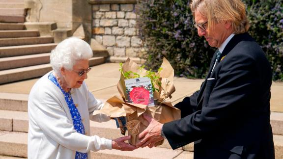 The Queen receives a Duke of Edinburgh rose from Keith Weed, president of the Royal Horticultural Society, in June 2021. The newly bred rose was officially named in honor of Prince Philip.