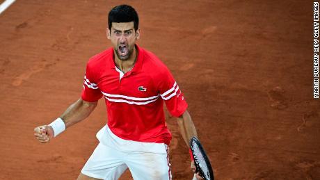 Novak Djokovic celebrates after winning against Italy's Matteo Berrettini at the French Open.