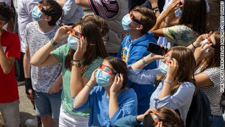 Students from the Broeders' School looking at a partial eclipse, in Roeselare, Belgium on Thursday, June 10.
