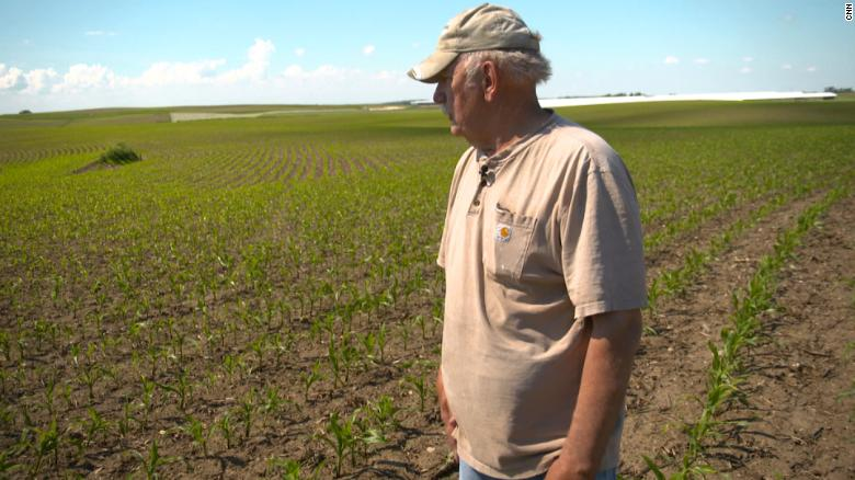 Farmer Brian Meyer looks over his 2000 acres in Monona, Iowa where he grows corn and soy beans. SOO Green is paying him to bury transmission lines along a rail line on is property that will bring renewable energy to Chicago.