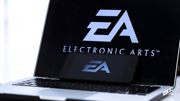 A photo shows the logo of 'Electronic Arts' video game company on a laptop screen.