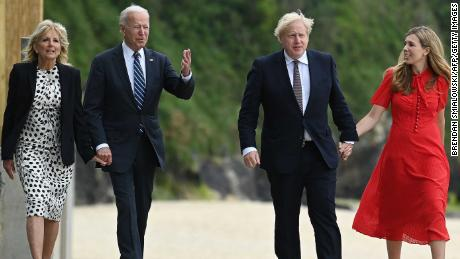 Britain's Prime Minister Boris Johnson and his wife Carrie Johnson walk with US President Joe Biden and US First Lady Jill Biden at Carbis Bay, Cornwall on June 10, 2021, ahead of the three-day G7 summit.