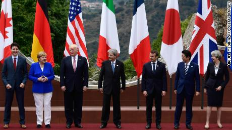Canadian Prime Minister Justin Trudeau, German Chancellor Angela Merkel, US President Donald Trump, Italian Prime Minister Paolo Gentiloni, French President Emmanuel Macron, Japanese Prime Minister Shinzo Abe, and Britain's Prime Minister Theresa May, pose for a family photo at the ancient Greek Theatre of Taormina during the Heads of State and of Government G7 summit, on May 26, 2017 in Sicily.