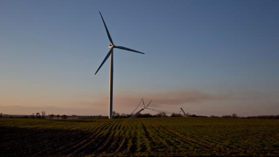 A wind turbine stands in an agricultural field outside Iowa Falls, Iowa on May 3, 2019.
