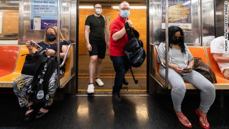 People ride the subway in New York City on May 26.