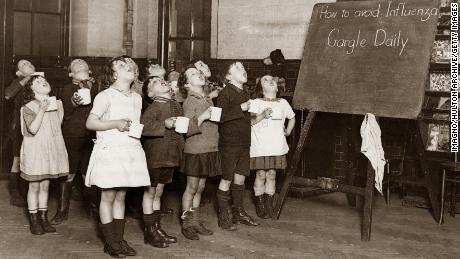 Schoolchildren gargle as a precaution against an influenza epidemic that happened in England sometime around 1935.