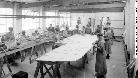 Although World War I made employers reconsider the jobs given to women, women often remained in traditionally feminine roles, like these women sewing fabric onto aircraft wings at an English factory in 1918. Elsewhere in this factory, however, women were beginning to work alongside men in jobs such as carpentry.