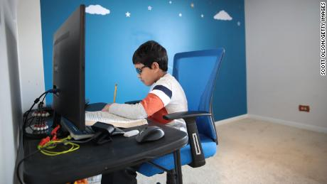 Hamza Haqqani, a then-second grader at Al-Huda Academy, participates in an e-learning class while at his home in Illinois on May 1, 2020.