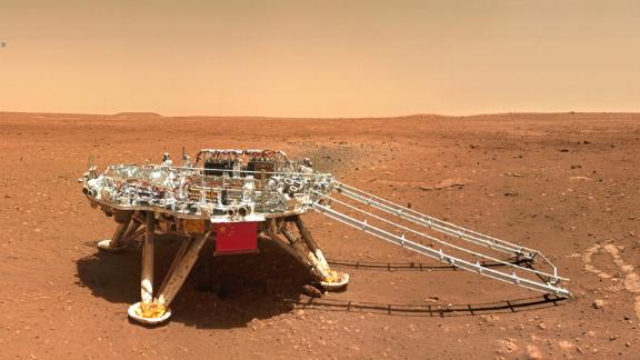 The rover's lander displays China's flag.