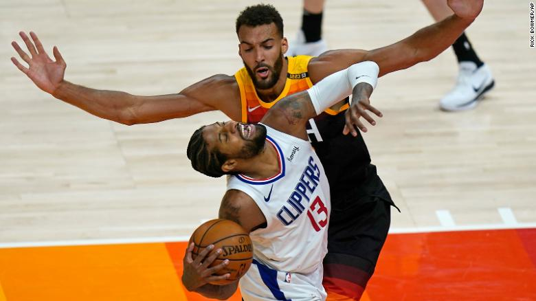 Utah Jazz center Rudy Gobert defends against LA Clippers guard Paul George.