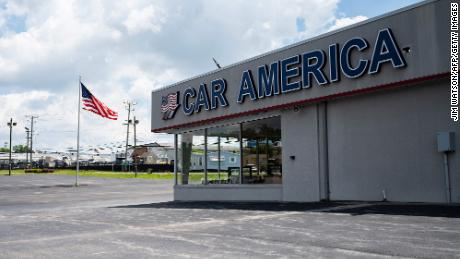 A car dealership stands empty in Laurel, Maryland, as many car dealerships across the country are running low on new vehicles as a computer chip shortage has caused production at many automakers.