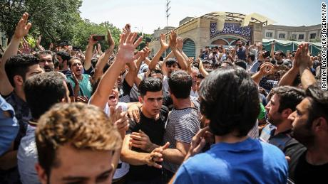 In this June 2018 photo, a group of protesters chant slogans at the main gate of the Old Grand Bazaar, in Tehran, Iran. The case of 27-year-old Navid Afkari has drawn the attention of a social media campaign that portrays him and his brothers as victims targeted over participating in protests against Iran's Shiite theocracy in 2018.