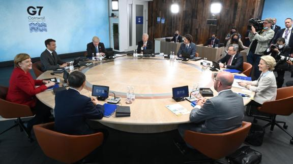 US President Joe Biden, Canada's Prime Minister Justin Trudeau, Italy's Prime minister Mario Draghi, President of the European Commission Ursula von der Leyen, President of the European Council Charles Michel, Japan's Prime Minister Yoshihide Suga, Germany's Chancellor Angela Merkel, France's President Emmanuel Macron and British Prime Minister Boris Johnson sit around the table at the start of the G7 summit in Carbis Bay, Cornwall on June 11, 2021.