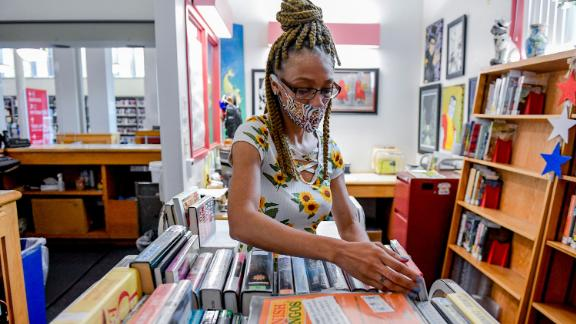 Librarian Sharice Towles at the Reading Public Library Main Branch in Reading, Pennsylvania, where officials have stopped charging fines on most library items because of the pandemic.