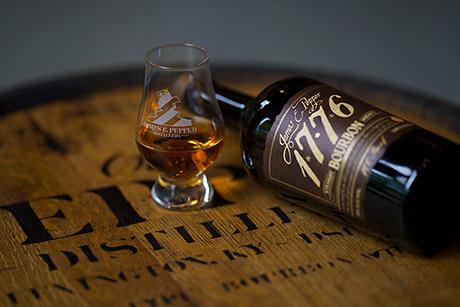 A bottle of James E. Pepper 1776 bourbon.