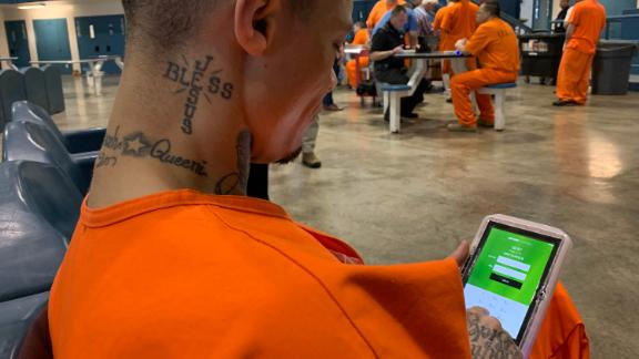 North Fork Correctional Center inmate Byron Robinson with his new computer tablet.