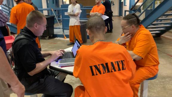 Inmates at the North Fork Correctional Center learn to use their tablets.