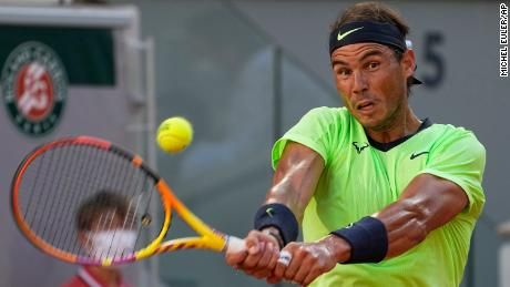 Spain's Rafael Nadal sends a backhand to Serbia's Novak Djokovic during their French Open semifinal.