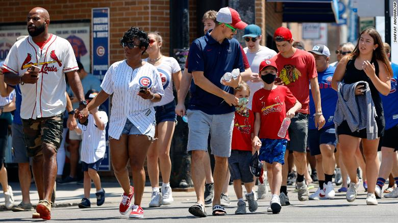 Fans make their way towards Chicago's Wrigley Field on Friday, as the city announced Covid-19 restrictions were lifted.