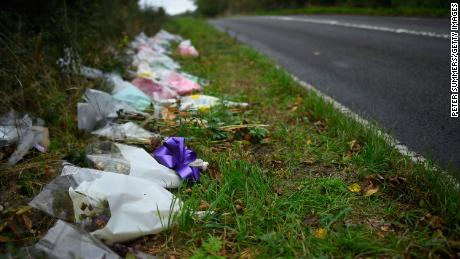 Flowers left in remembrance of Harry Dunn on the B4031 road near RAF Croughton in 2019.