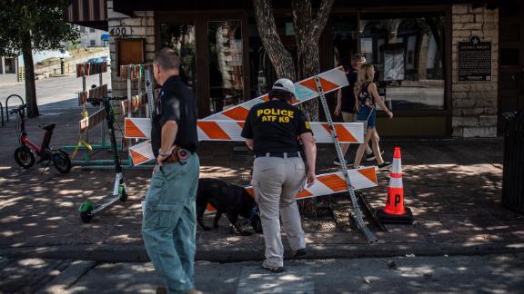 An ATF K9 unit surveys the area near the scene of the shooting