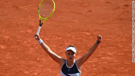 Barbora Krejcikova celebrates after winning the French Open singles title.