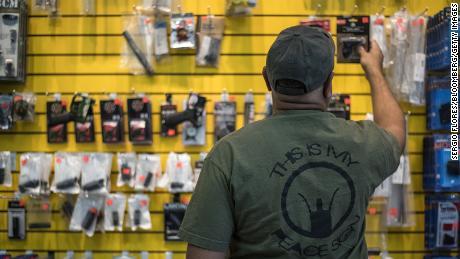 A customer reaches for a gun grip at ABQ Guns in Albuquerque, New Mexico, in September 2016.