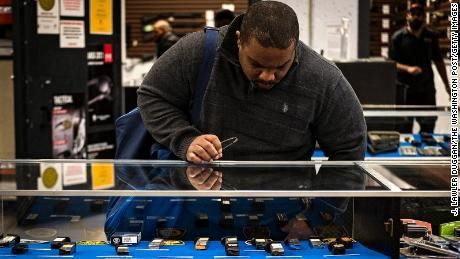 Stephen Yorkman, president of the Prince George's County chapter of the National African American Gun Association, window-shops for pistol clips while he waits his turn for a shooting lane at the Maryland Small Arms Range in Upper Marlboro, Maryland, on Saturday, March 4, 2017.