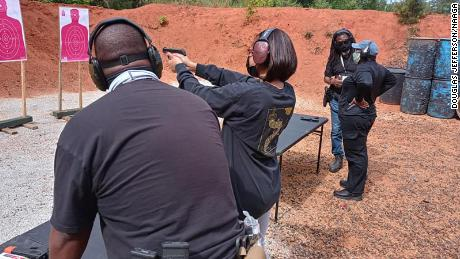 Members of the National African American Gun Association work on their aim at a shooting range in this undated photo.
