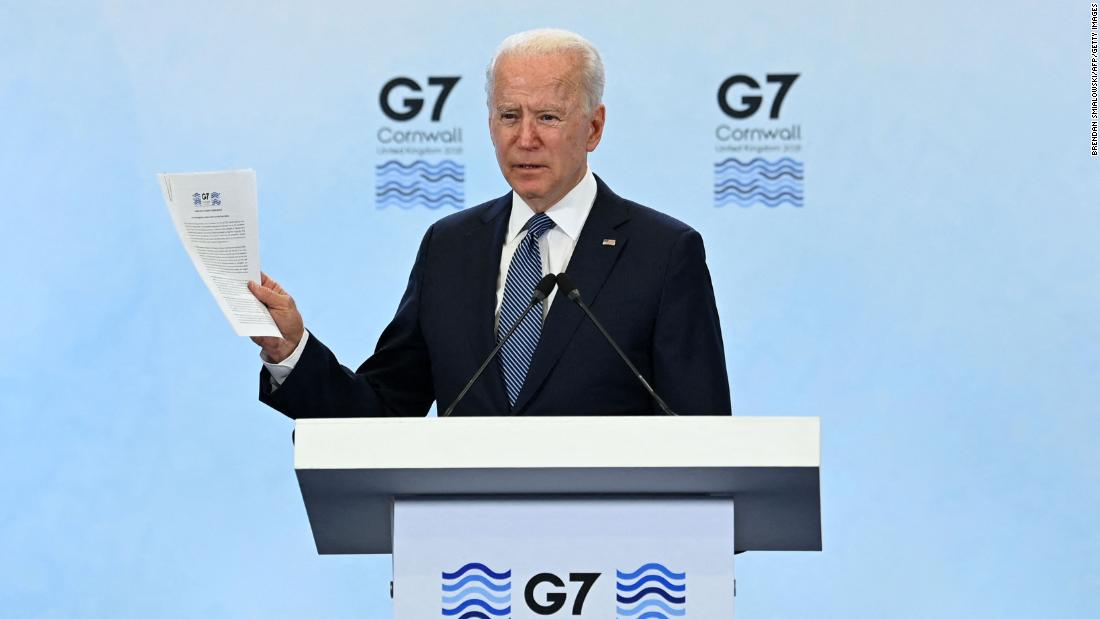 In his first overseas news conference, Biden says 'America is back at the table'