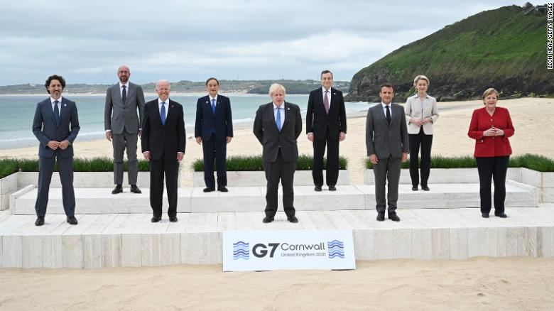(L-R) Canadian Prime Minister Justin Trudeau, President of the European Council Charles Michel, US President Joe Biden, Japanese Prime Minister Yoshihide Suga, British Prime Minister Boris Johnson, Italian Prime Minister Mario Draghi, French President Emmanuel Macron, President of the European Commission Ursula von der Leyen and German Chancellor Angela Merkel, pose for the leaders official welcome during the G7 summit in Carbis Bay.
