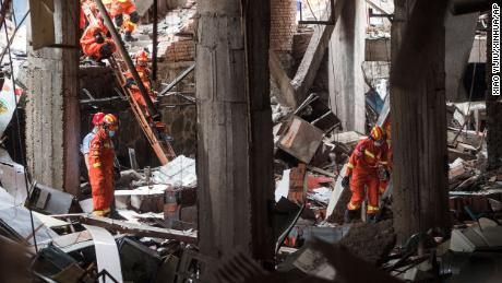Rescue workers search for survivors in the aftermath of a gas explosion in Shiyan city in central China's Hubei Province on Sunday.