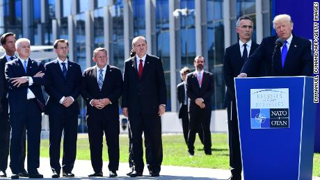 From left: Dutch Prime Minister Mark Rutte, Montenegro's Prime Minister Dusko Markovic, Slovenian Prime Minister Miro Cerar, Danish Prime Minister Lars Lokke Rasmussen, Turkish President Recep Tayyip Erdogan, and NATO Secretary General Jens Stoltenberg listen to US President Donald Trump's speech during the unveiling ceremony of the Berlin Wall monument, during the NATO summit in Brussels on May 25, 2017.