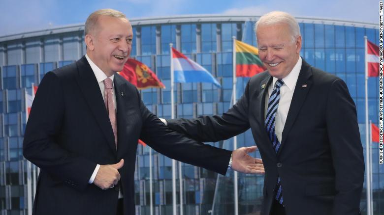 Turkish President Recep Tayyip Erdogan (L) greets US President Joe Biden (R) at the NATO summit at the North Atlantic Treaty Organization headquarters in Brussels, on June 14, 2021.