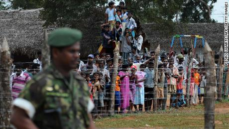 Displaced Tamil civilians during a visit by the then French and British Foreign Ministers at Kadirgamh camp in Chettikulam, northern Sri Lanka, April 2009.