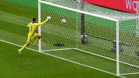 Scotland goalkeeper David Marshall couldn't get back in time and watched as the ball sailed over him.