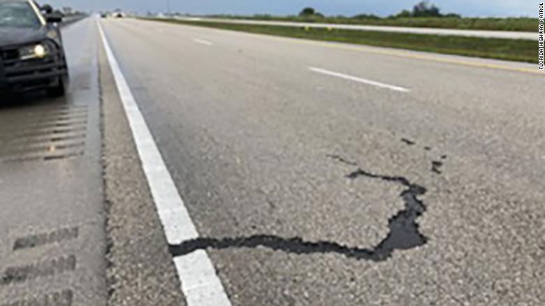 Lightning strike leaves 7-foot gouge in Florida highway after hitting vehicle