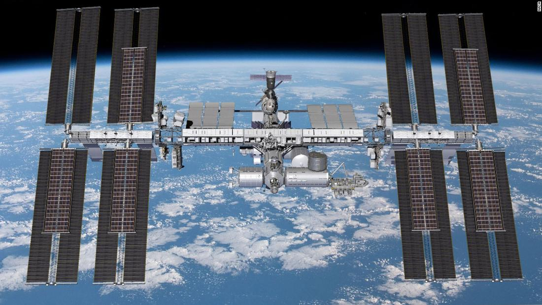 Astronauts begin spacewalk to install solar panels on International Space Station