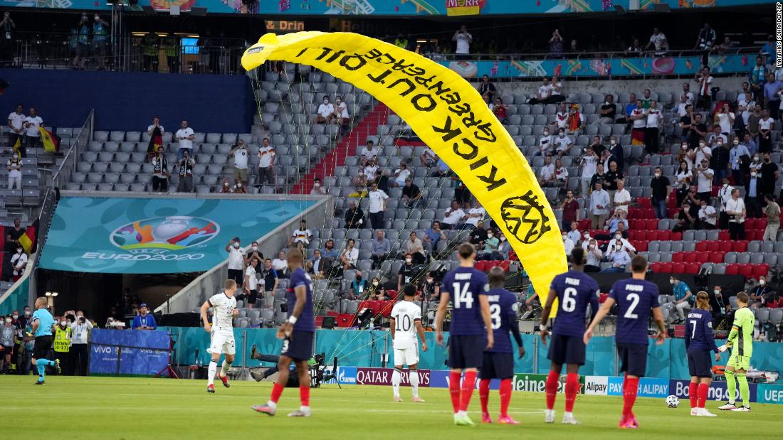Germany vs. France: 'Kick out oil' protester parachutes into Allianz Arena stadium ahead of Euro 2020 match – CNN International