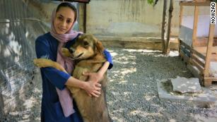 Dr. Hamida with Ragnar, one of 1,600 dogs Nowzad has helped reunite with soldiers who rescued them since 2006. The group does not use surnames of Afghani staff to protect their families.