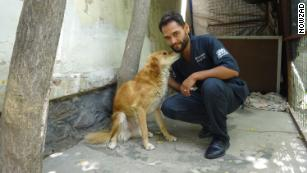 Dr. Reshad with Julie, one of 1,600 dogs Nowzad has helped reunite with soldiers who rescued them since 2006. The group does not use surnames of Afghani staff to protect their families.